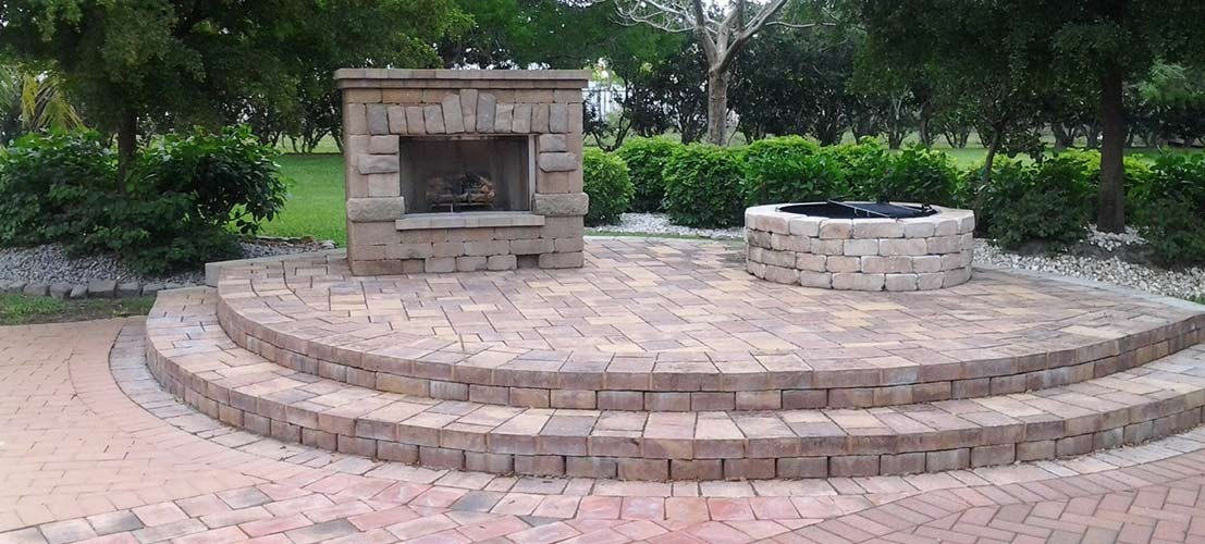 stone outdoor fireplace and pavers