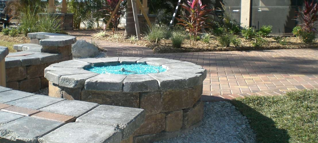 stone fire feature and pavers