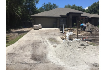 Concrete driveway removed. Wall construction.