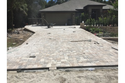 Wall completed. New pavers being installed