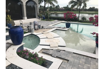 Pool paver installation nearing completion