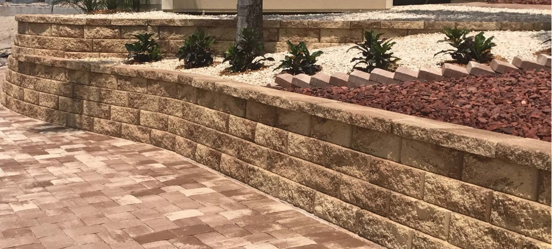 Stone retaining wall and pavers