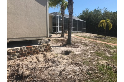 Site before wall, pavers and landscaping