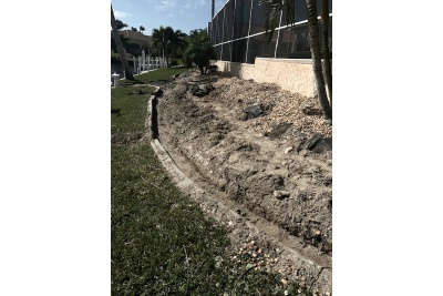 Landscaping and retaining wall preparation
