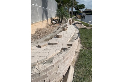 Paver installation and retaining wall construction